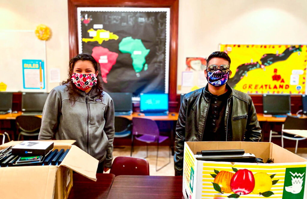 LAYC Career Academy Alumni Tatiana Contreras and Anthony Toyos repair computers for their school community amidst a global pandemic.